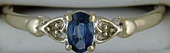 A Ladies Diamond and Blue Stone Ring