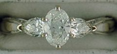 Ladies 1ctw Oval and Pear Cut Diamond Engagement Ring