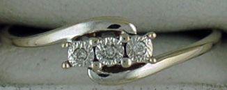 Ladies Twist Style Past, Present and Future Diamond Chip Ring