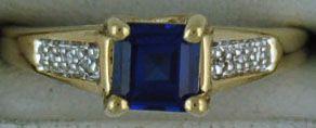 Ladies Blue Stone and Diamond Chip Ring