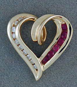 1/4ctgw Ruby and Diamond Heart Pendant