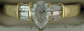 Ladies 9/10ctw Pear and Baguette Diamond Engagement Ring