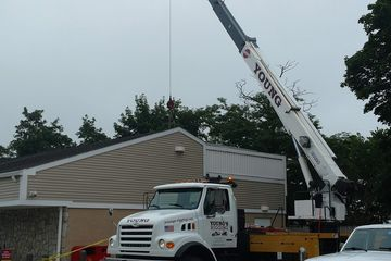 Crane rental with heavy equipment transport and installation.
