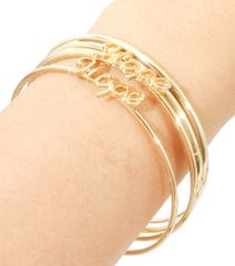 Gold metal bangle bracelet with love words. Gold Plating / Material.