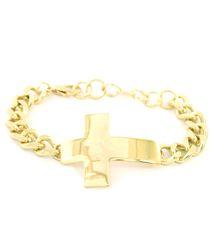 CROSS BRACELET IN GOLD TONE. GOLD PLATING / MATERIAL.