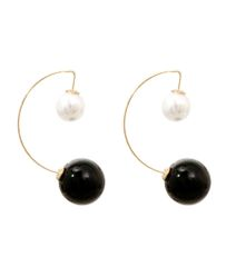 Gold metal curved earrings with black and cream two separated pearl studs. Hook closure. 2.5 Inches Long, Gold Plating / Material.