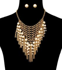 Gold metal chain necklace set with drop cream pearls and tassel chain. Lobster clasp closure. 18 Inches Long