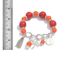 RED RESIN, GLASS CHARM BRACELET IN SILVER-TONE. A 10304