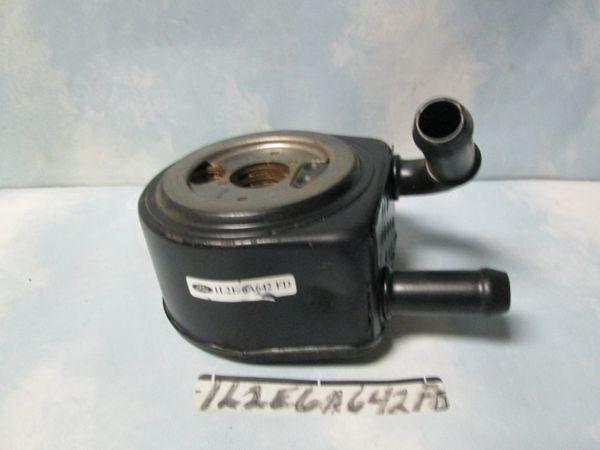 1L2E-6A642-FD FORD OIL COOLER NEW