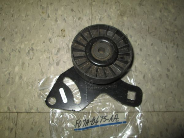F07A-8675-AA FORD RANGER OEM DRIVE IDLER PULLEY NEW