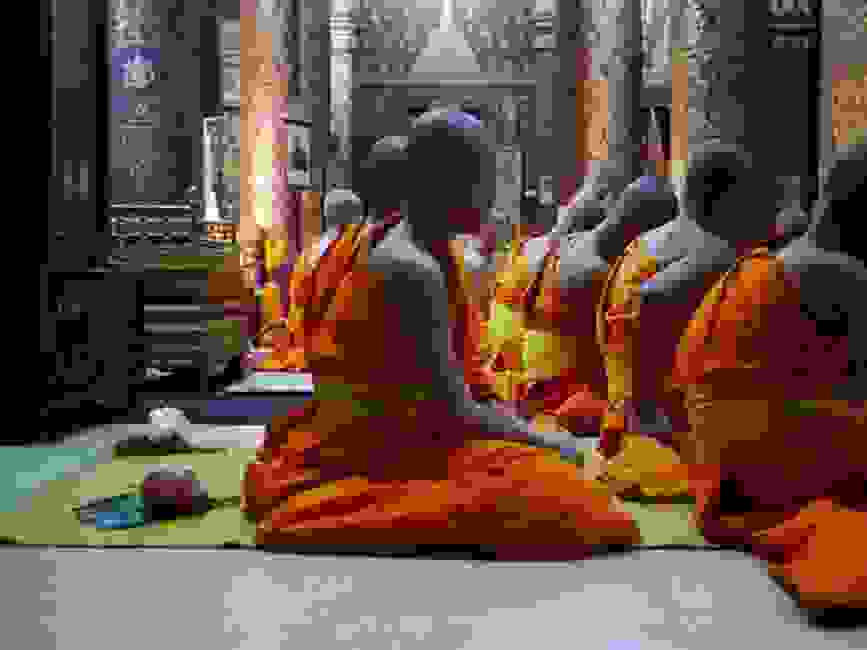 Young buddhist monks in temple.