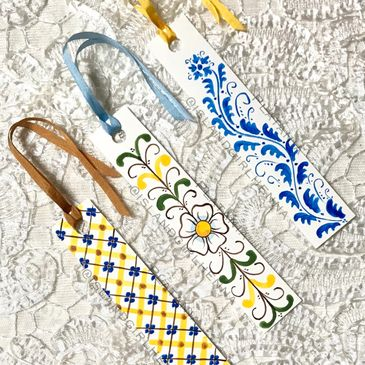 Hand painted maiolica style ornaments and bookmarks.