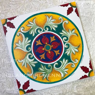 Deruta inspired red tulips, cobalt blue, verdigris and gold foliage. Circular with floral accents.