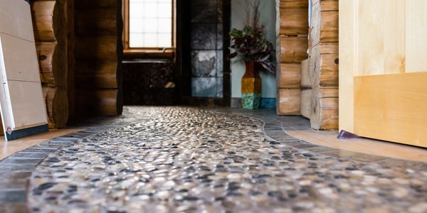Custom stone inlay into hardwood floor at Stevens Point Log Homes model office