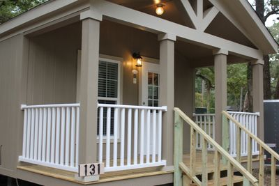 Front porch entry for a Cottage for purchase or rent at Crockett Family Resort & easttexascottages.com