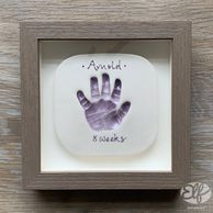 Framed 8 week old baby hand clay imprint, coloured, glazed & kiln-fired