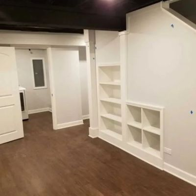 built in shelves in cabinetry, baseboard and door casing installation located in the basement.