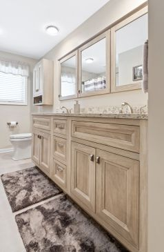 Bathroom remodel in Lindenhurst, Illinois with vanity and ceramic shower tile.