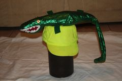 GATOR LARGE GREEN AS HAT DECORATION.
