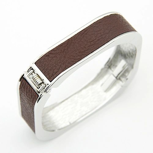Solid bangle with leather inner