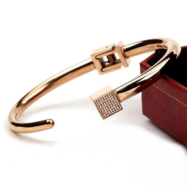 Stainless steel hinged bracelet with jeweled cube end