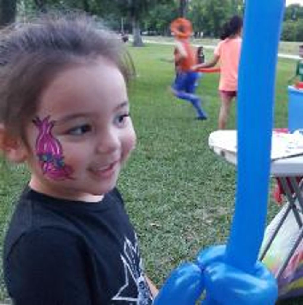 Girl at a special event in Jersey village get a Troll painting & a balloon sword from our artist