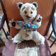 Crocheted teddy bear with music box  plays Lullaby