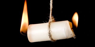 Candle burning from both ends symbolic as compassion fatigue
