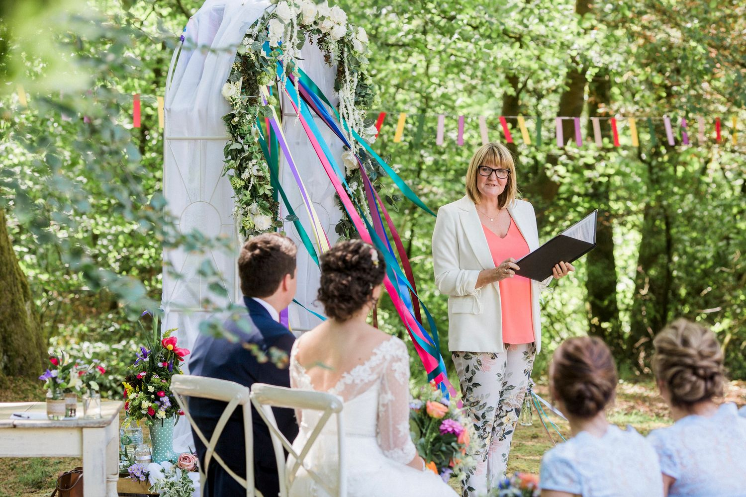 Bruce and Holly's fabulous festival themed celebrant led woodland wedding ceremony.