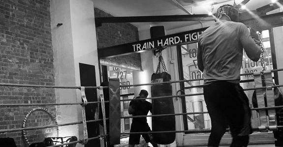 Perennial Boxing + Fitness Coach Ralph Gilmore shadowboxing workout at Work Train Fight gym in NYC.