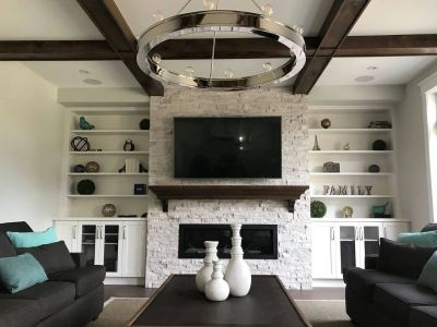 tv mounted over fireplace in ceiling speakers surround sound