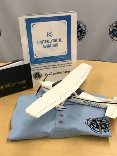 The Plane, logbook, and camp shirt