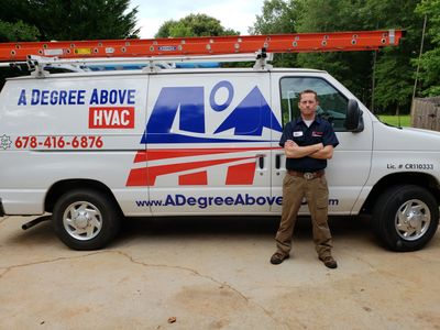 A Degree Above HVAC van and technician.