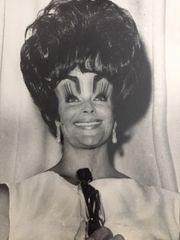 "WEEGEE (ARTHUR FELLIG) VINTAGE DISTORTION PHOTOGRAPH OF ELIZABETH TAYLOR WITH OSCAR, SILVER GELATIN, C. 1960'S, 7.25 X 8.5, WITH STAMP, ""WEEGEE 451 WEST 47TH STREET NEW YORK CITY U.S.A. TEL"""