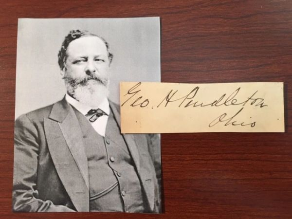 GEORGE H. PENDLETON SIGNED SLIP, PRES. KENTUCKY CENTRAL RR, JAMES A. GARFIELD