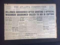 JOHN DILLINGER FRONT PAGE HEADLINE THE ATLANTA CONSTITUTION: DILLINGER SURROUNDED AFTER SHOOTING 2 OFFICERS; WISCONSIN GUARDSMEN CALLED TO AID IN CAPTURE AND COPIES OF FBI WANTED POSTER AND CHICAGO CORONERS DEATH CERTIFICATE