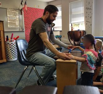 Mr. G teaching a student on a xylophone