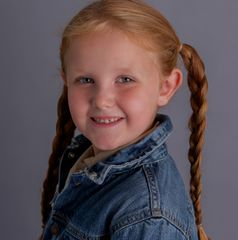 redhaired girl with braided pigtails