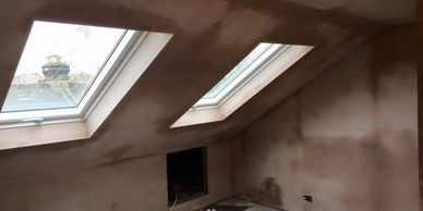 Essex and London Construction. Velux roof. Loft conversions near me. Windows in family home fit out.