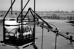 T230-OS3 -Tractor mounted offset boom with two 30gal. tanks, holds three 3gal. containers