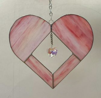 Pink heart with heart shaped jewel