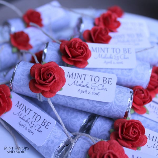 Red roses on grey mint wedding favors with personalized tags