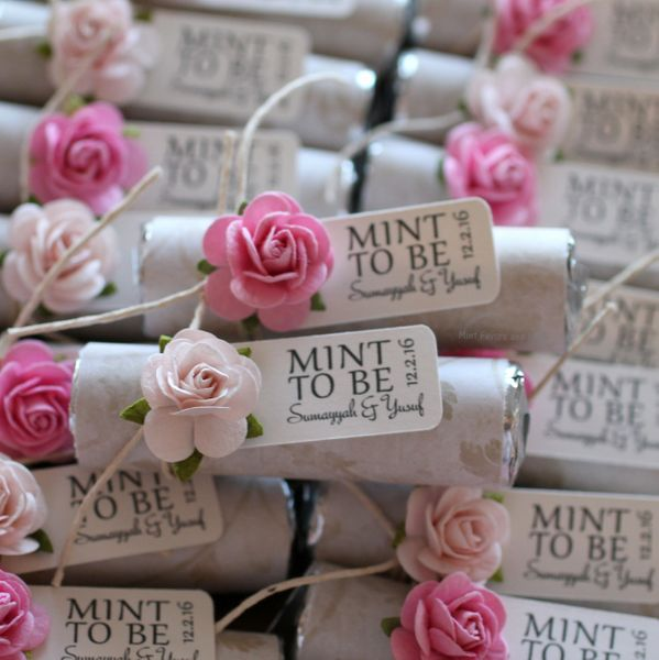 blush and pink wedding favors with ivory wraps, personalized mints