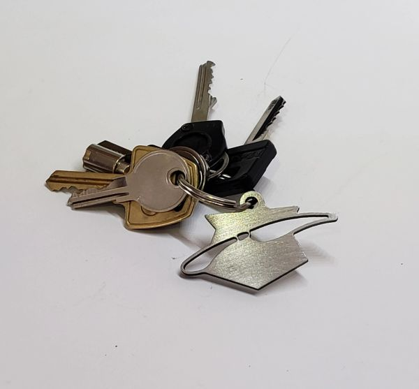 "One-of-a-Kind ""Pinhead"" Metal Key Chain Emblems"