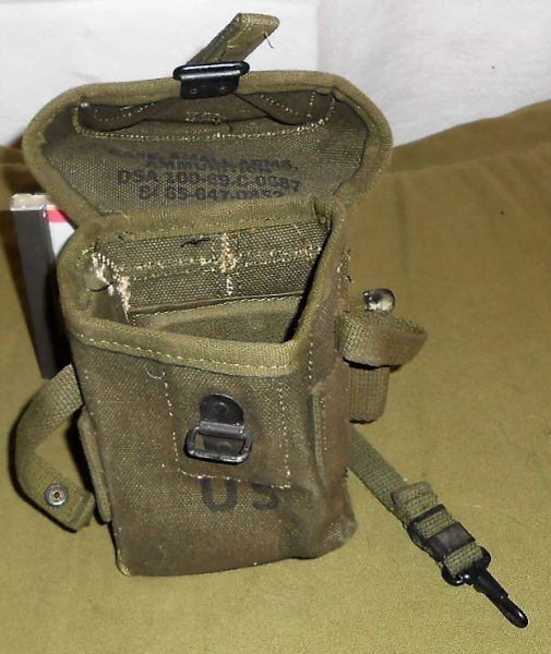 "two magazine pouch marked ""Case, Small Arms, / Ammunition / DSA 100-69-C-0687 / 8465-647-0852. For M-14 rifle"