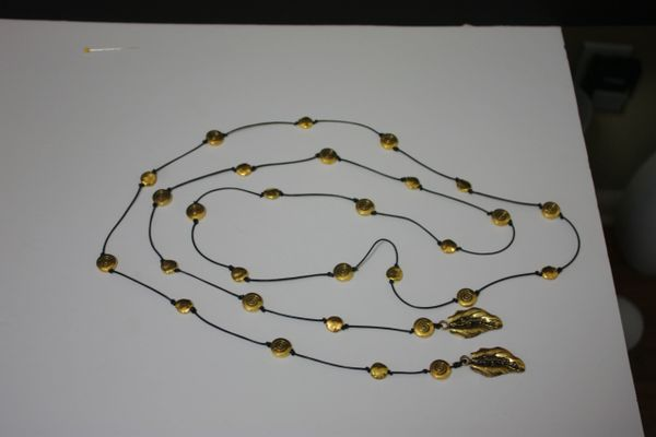 Black Leather Lariat Necklace with Gold Metal Beads and Gold Leaf Charms
