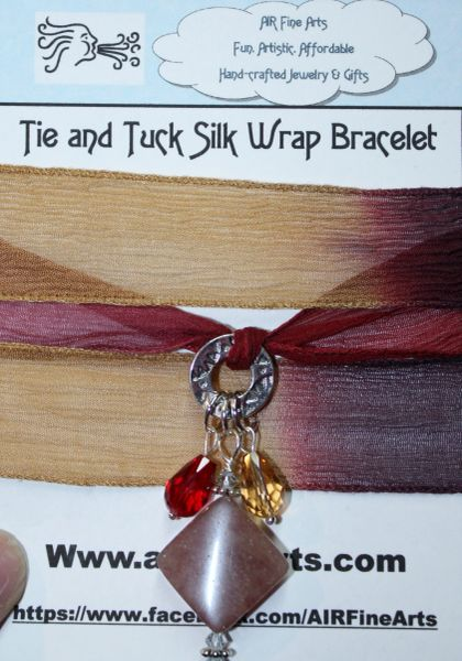 "Hues of Purple, Ruby and Camel Silk ""Tie and Tuck"" Wrap Bracelet Embellished with Melon Tourmaline and Red and Gold Crystal Charms"