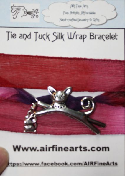 "Hues of Red and Magenta Silk ""Tie and Tuck"" Wrap Bracelet Embellished with Silver Cat and Mouse Charms"
