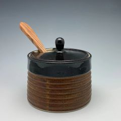 """Rusty"" sided lidded jar with wooden spoon"
