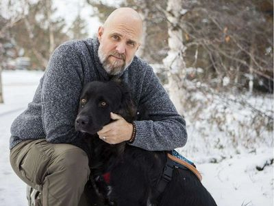 Retired Canadian Forces Captain Paul DeGroot and Service Dog Raven